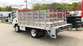 Aluminum rack body with galvanized tuck away lift gate